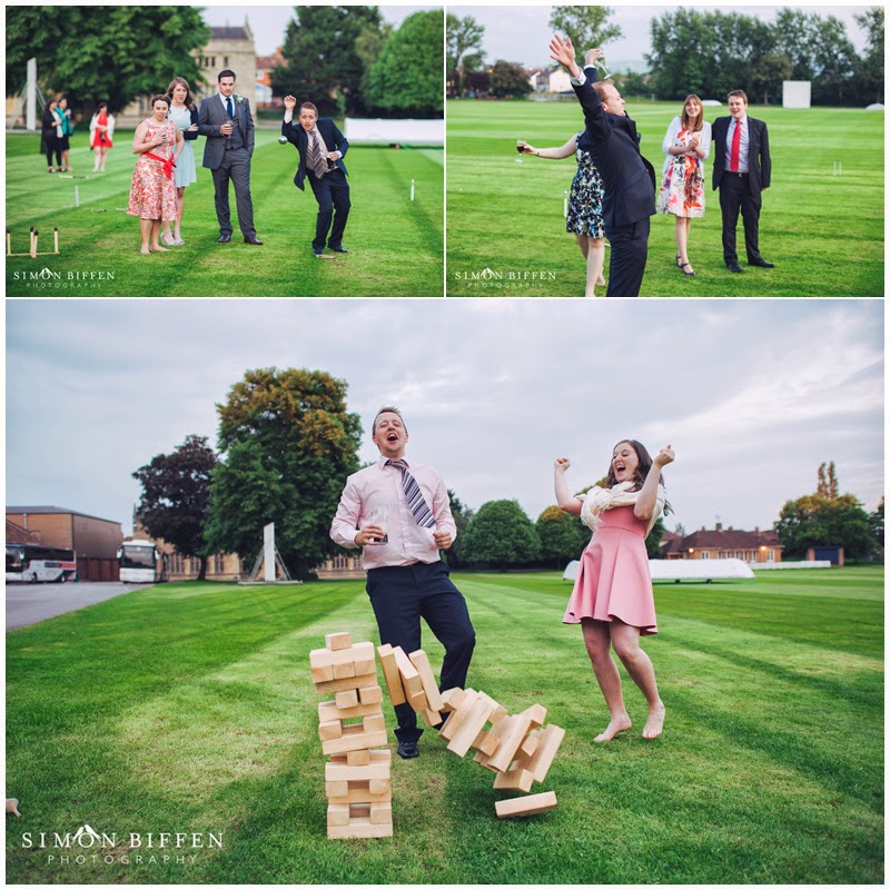 Guests playing garden games at wedding reception photography at Taunton School
