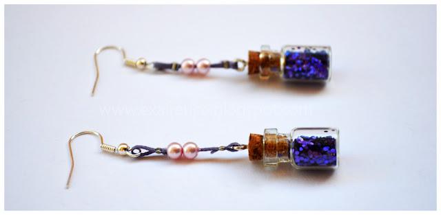 EAR.045 Σκουλαρίκια με μαγικό μπουκαλάκι σε μωβ χρώμα