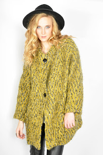 Vintage 1980's yellow chevron wool coat with black buttons.