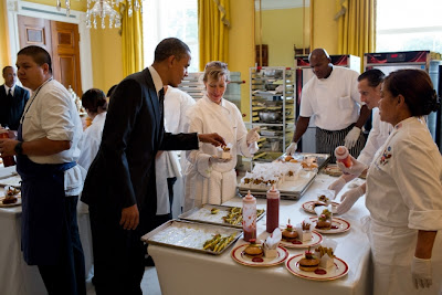 President Obama samples a baked zucchini fry in the Old Family Dining Room after the Kids' State Dinner Aug. 20, 2012. (Official White House Photo by Pete Souza)