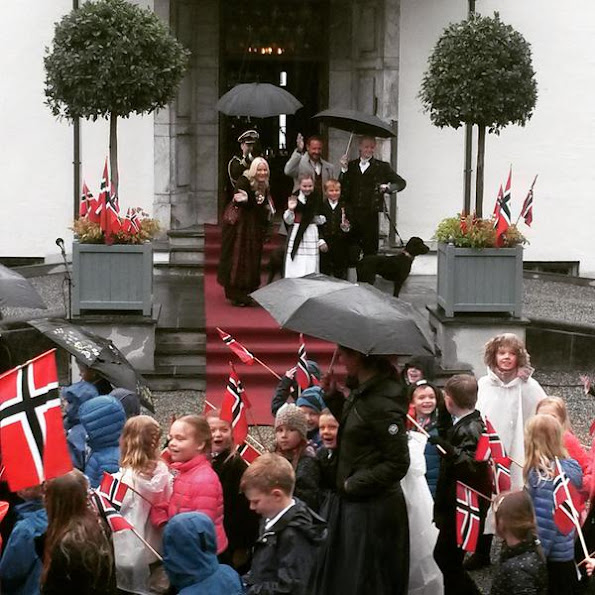Crown Prince Haakon of Norway and Crown Princess Mette-Marit of Norway with Princess Ingrid Alexandra, Prince Sverre Magnus and Marius Borg Høiby greet the Childrens Parade on the Skaugum Estate