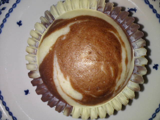 For the Marbled Mushi Pan, scoop plain and cocoa batter alternately ...