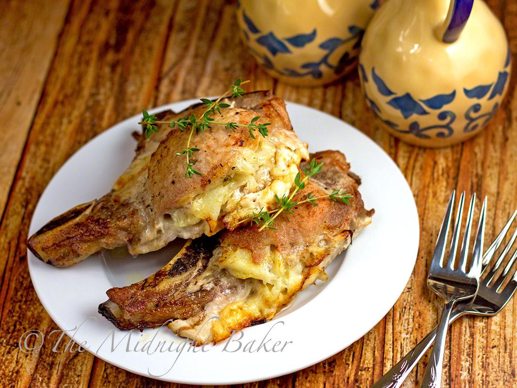 Cheese & Potato Stuffed Pork Chops | bakeatmidnite.com | #porkchops #slowcooker #cheesestuffedporkchops