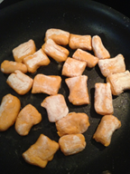 Sweet potato gnocchi being cooked in saute pan
