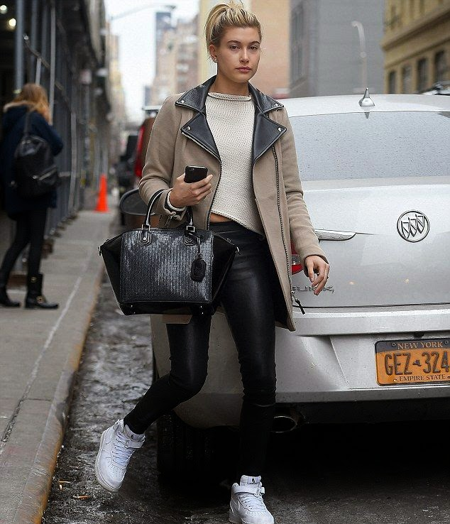 The 18-year-old walking alone at the street at New York on Saturday, February 14, 2015 in a brown lapel jacket and black legging.