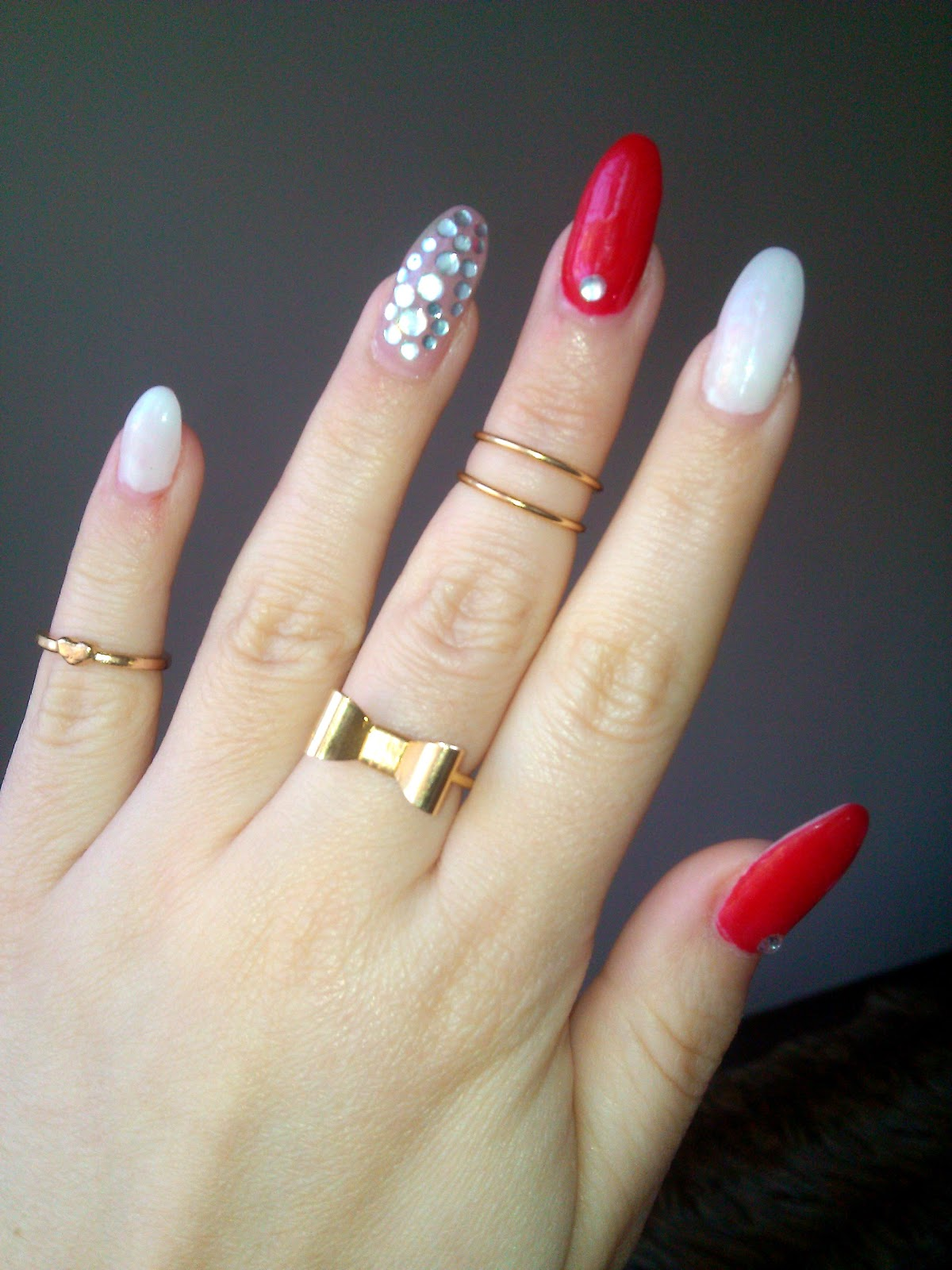 gold midi rings, red stiletto nails, stiletto nails, stiletto nails with rhinestones, white stiletto nails