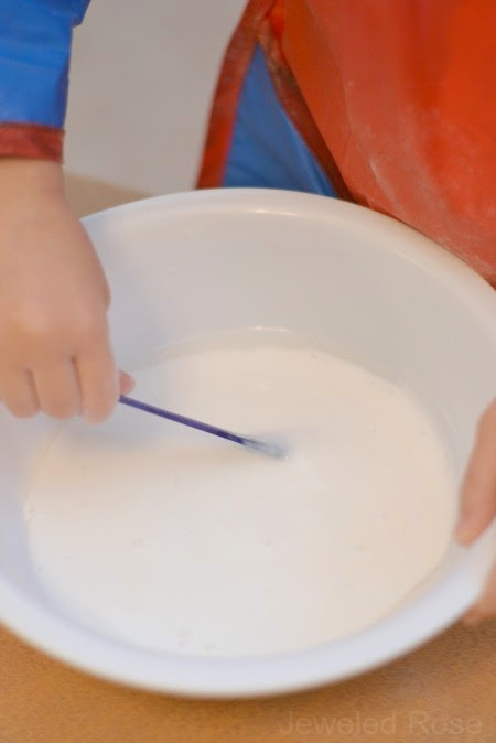 Snow slime is icy cold and sparkly white- such a fun way for kids to play with snow this Winter