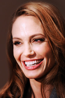 Cute Smile Angelina Jolie with high quality background wallpaper for mobiles and tablets