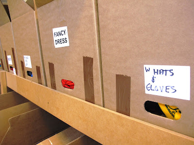 A run of labelled cardboard boxes.