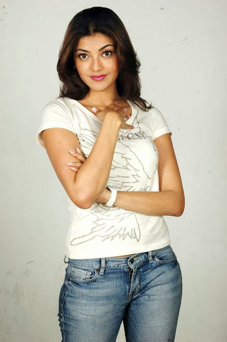 Kajal Agarwal in a very tight white shirt shows off cleavage
