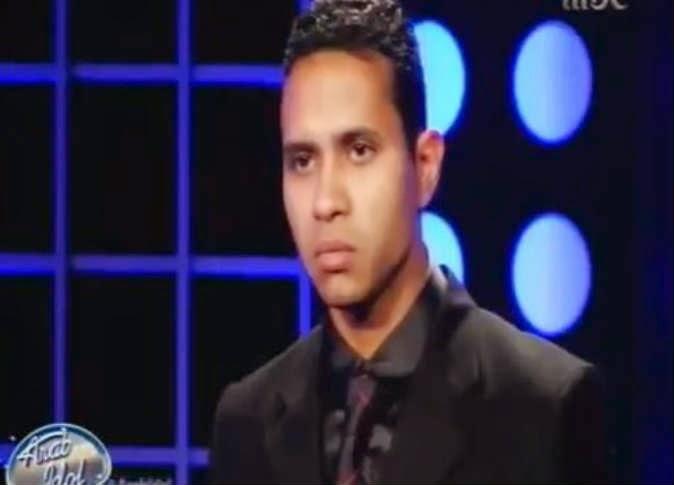 شاهد بالفيديو...رد فعل الشاب المصري على رأي لجنة التحكيم في صوته !!