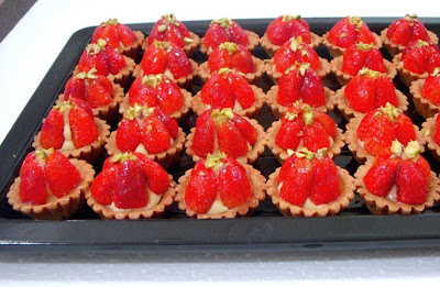 Fresh strawberries tart pair with orange scented pastry cream and ...