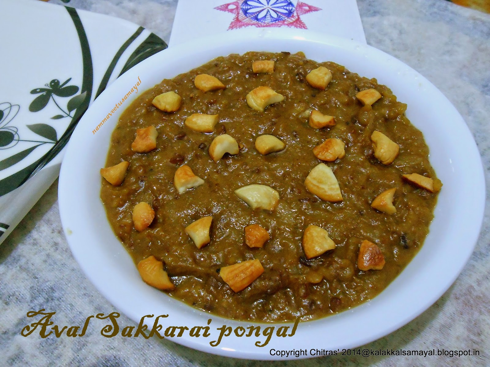 Spread roasted cashews over Rice flakes sakkarai pongal