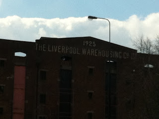 Ghost sign for the Liverpool Warehousing Company, Old Trafford, Manchester