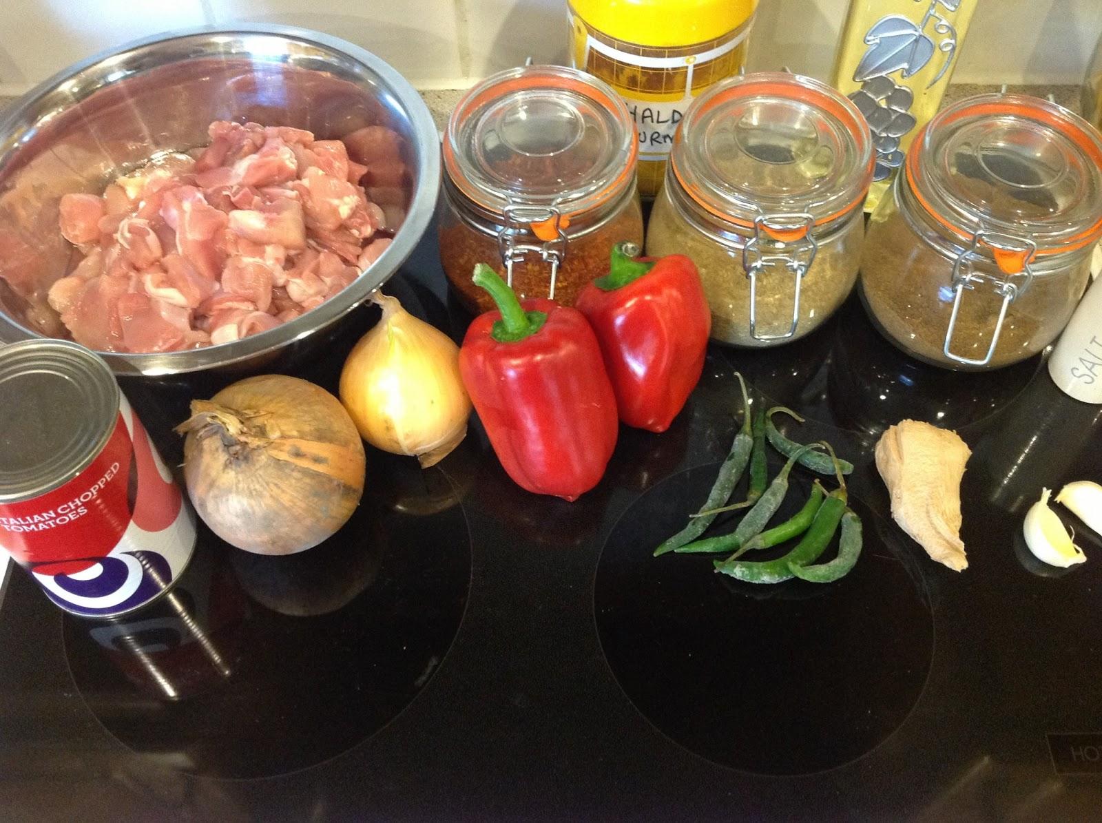 Boneless Chicken Pieces 2 Chopped Tomatoes Tin 3 Onions 4 Red Bell  Peppers 5 Green Chillies 6 Fresh Garlic 7 Fresh Ginger 8 Salt 9 Ground  Cumin