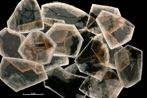 Muscovite mica from the Loch Nevis Mica Prospect, Knoydart, Invernessshire.  Specimens of graded mica classed as 'Graded No 5 1/2 good stained'. The specimens of muscovite mica would have been worked at the Pitlochry Sorting Factory during the Second World War.