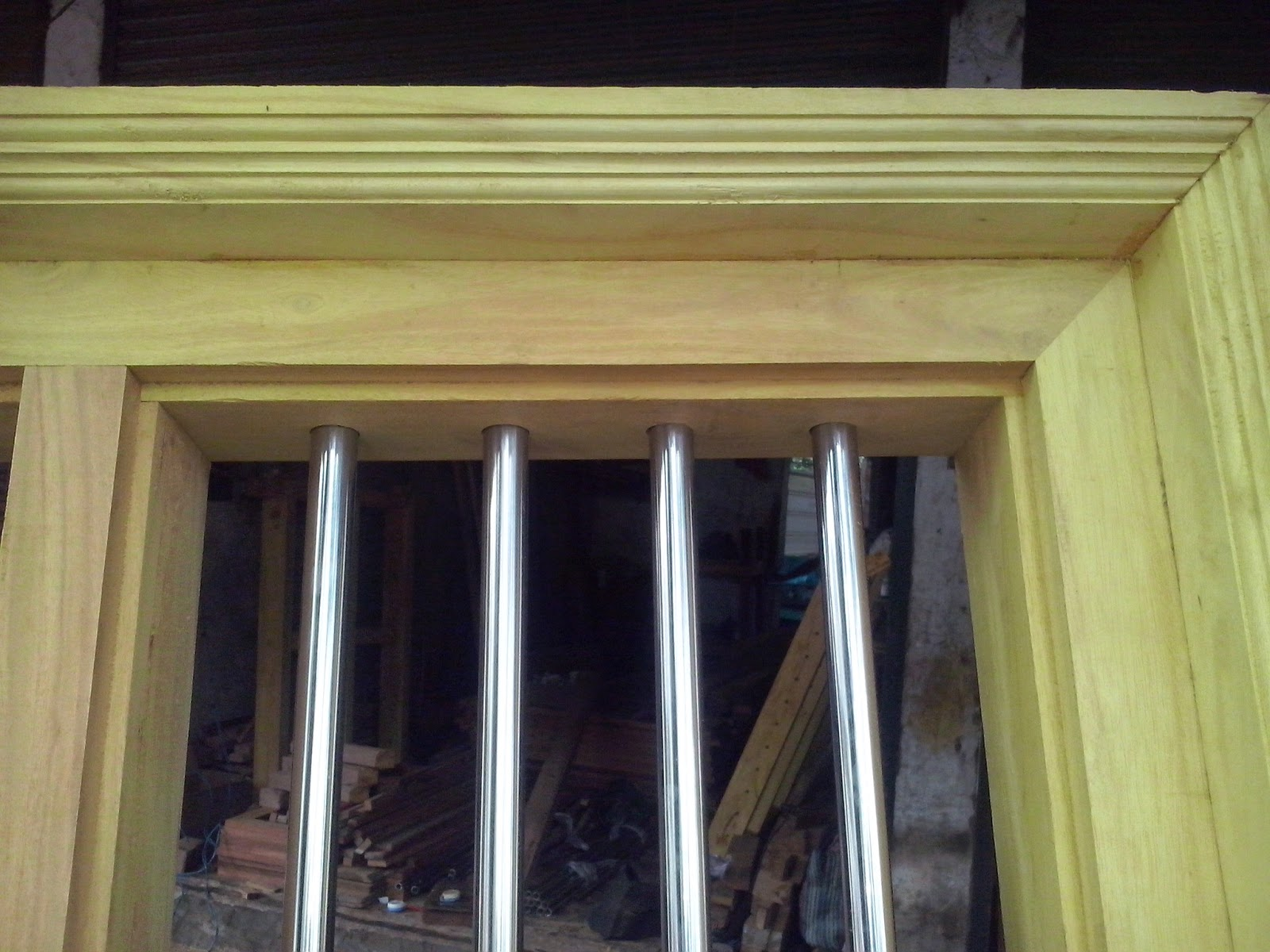 Kerala style carpenter works and designs wooden window for Window frame design
