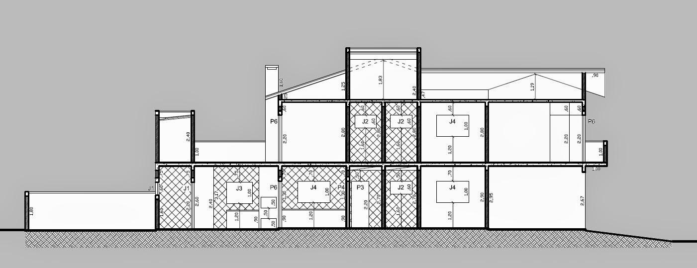 O corte longitudinal do projeto identifica a concentração das áreas molhadas da construção: sanitários, cozinha, churrasqueira e lavanderia.