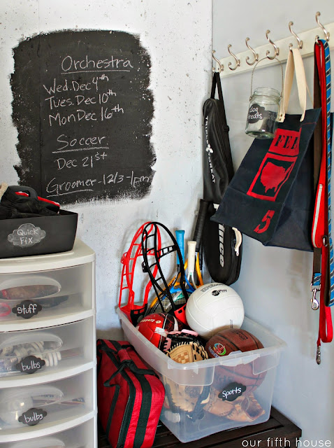 hand painted chalkboard sign in a garage mudroom