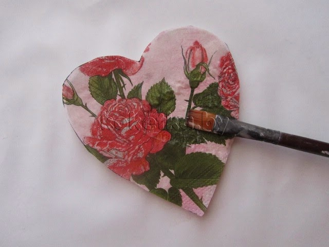Wooden heart with his hands