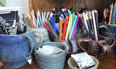 containers of art supplies