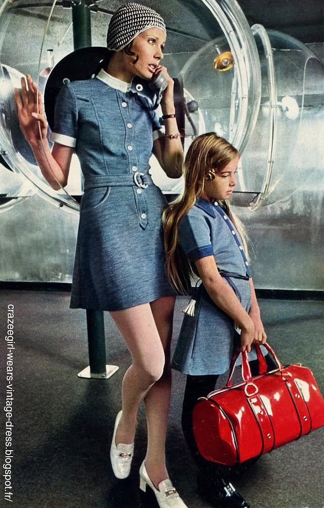 Vanessa porte une robe chemisier encolure polo et poignets blancs en jersey Oxford Courtelle ( Bagheera) Mocassins vernis blancs ( Cécil ) . Petit bonnet au crochet en coton bicolore ( Colette Barles ) .   Pour sa fille , une robe en jersey Gwendacril , les parements sont marine plus foncé ( Nouvelles Galeries ) Mocassins vernis à boucle d'argent ( Aster ) . Sac fourre-tout ( Nouvelles Galeries )          vintage 60s 1960 70s 1970 mini dress faux denim mod twiggy  patent white chunky heels  loafers