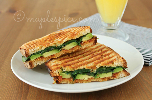 Vegan Pan-Grilled Sun-Dried Tomato Pesto, Avocado, Baby Spinach and Basil Sandwich.