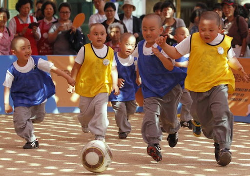 Young Korean monks play football