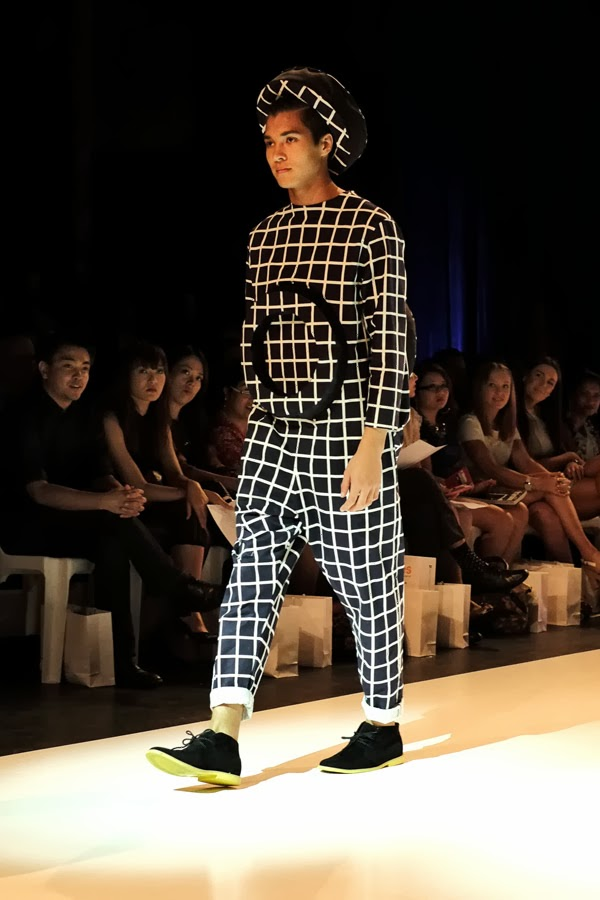 Matiny Ng; black and white criss-cross pattern with large raised circle motif on front and back of one-piece pant-suit with matching hat - Menswear : Raffles Graduate Fashion Parade 2013 Photography by Kent Johnson.