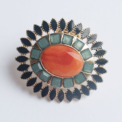 Francesca's gold, orange and jade ring