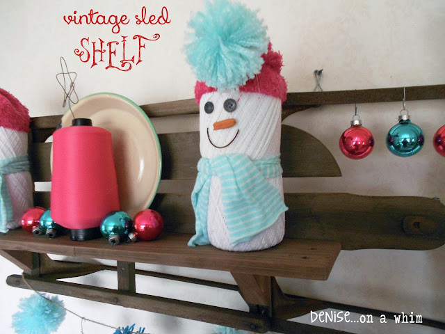 A vintage sled turned shelf decked out in teal and pink for Christmas via http://deniseonawhim.blogspot.com