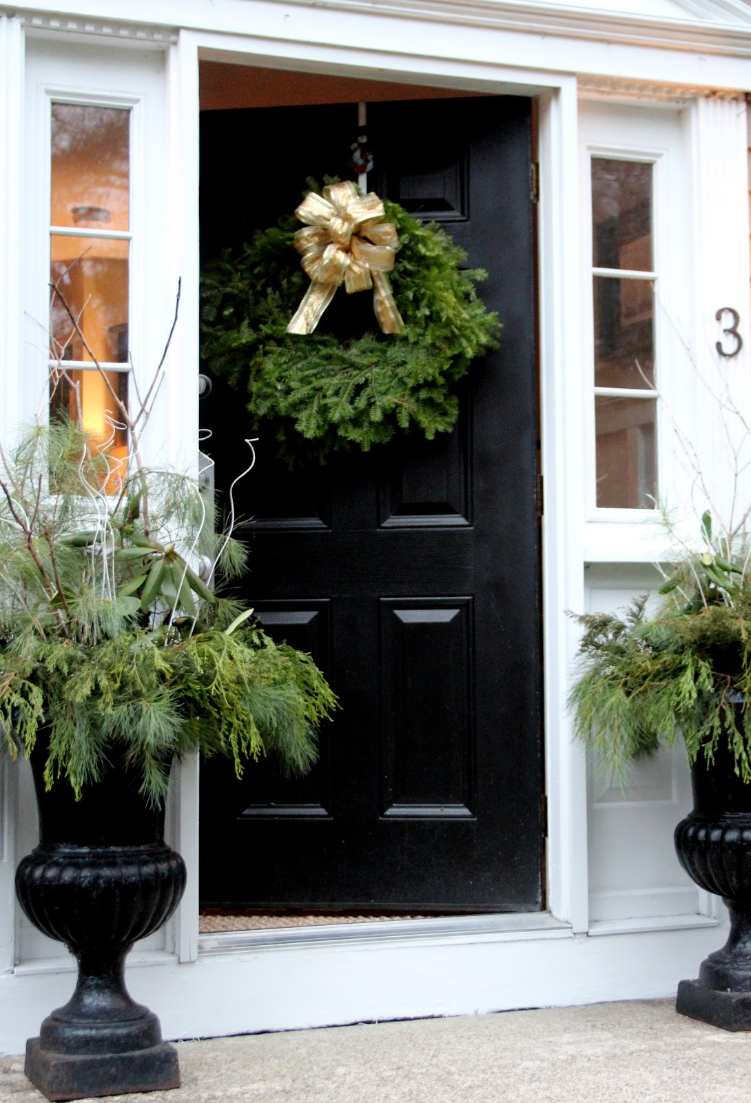 A peek into our christmas home shine your light i love to use fresh evergreens from our yard here there and everywhere starting with the urns at the front door here is a great tutorial for how to put rubansaba
