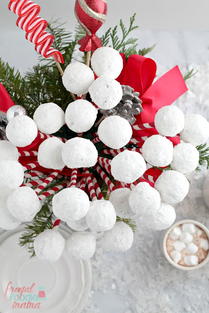 Create an easy & festive edible centerpiece for your holiday breakfast table with this Snowball Donut Hole Bouquet.
