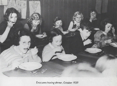 Evacuees having dinner, October 1939