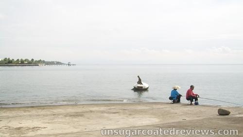 men fishing at the baywalk