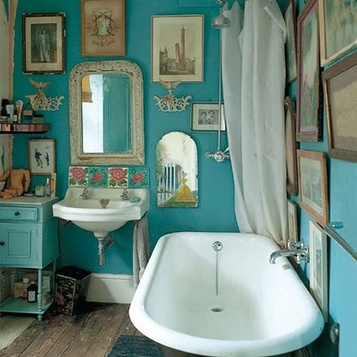 Colorful walls  mismatched vintage art. Dishfunctional Designs  The Bohemian Bathroom