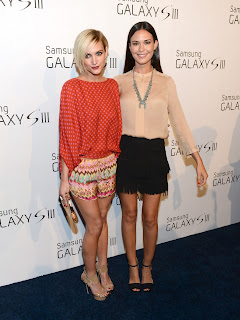 Odette Annable and Ashlee Simpson posing together on the red carpet in LA