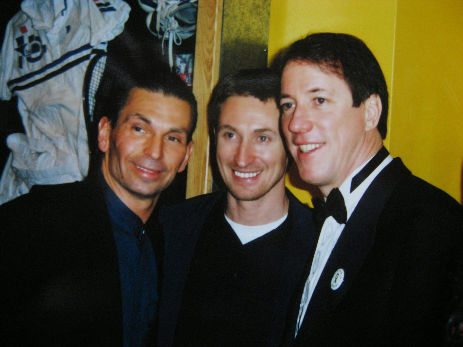 Wayne Gretzky in the center, Jim Kelly on the right and I can't remember the guy on the left