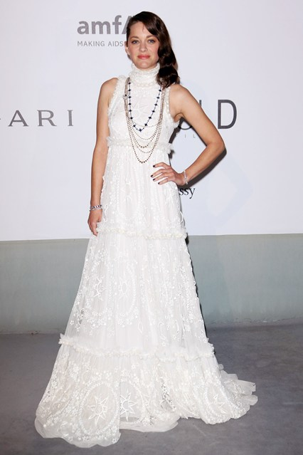 Marion Cotillard wore an Alexander McQueen autumn/winter 2014 gown with jewellery by Chopard at Cannes, AmfAR Gala 2014