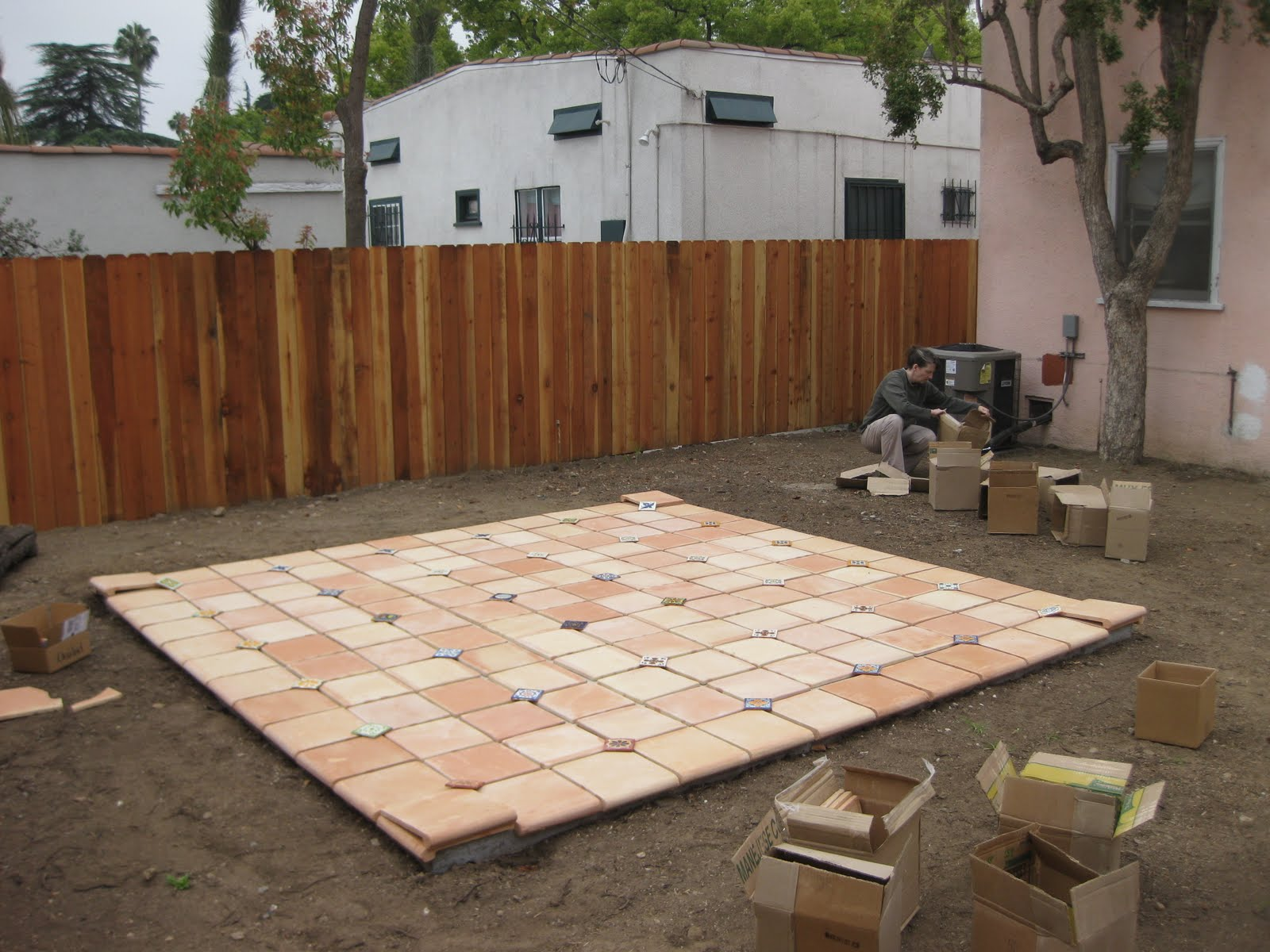 Pink Spanish Laying Out Patio Tile