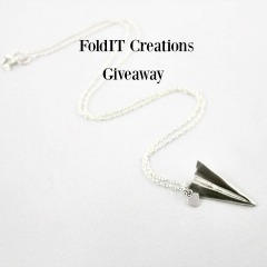 Win a silver origami-inspired necklace or earrings. Click pic to enter. Ends 6/25 Worldwide