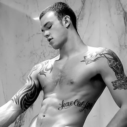 Pornstar with tattoo on left shoulder