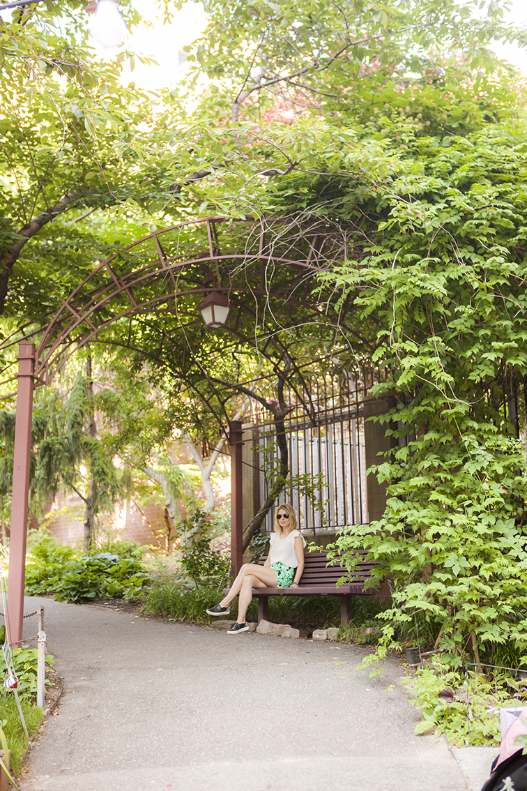 Under the lush gazebo, in the park, nature haven in New York City, West Side Community Garden