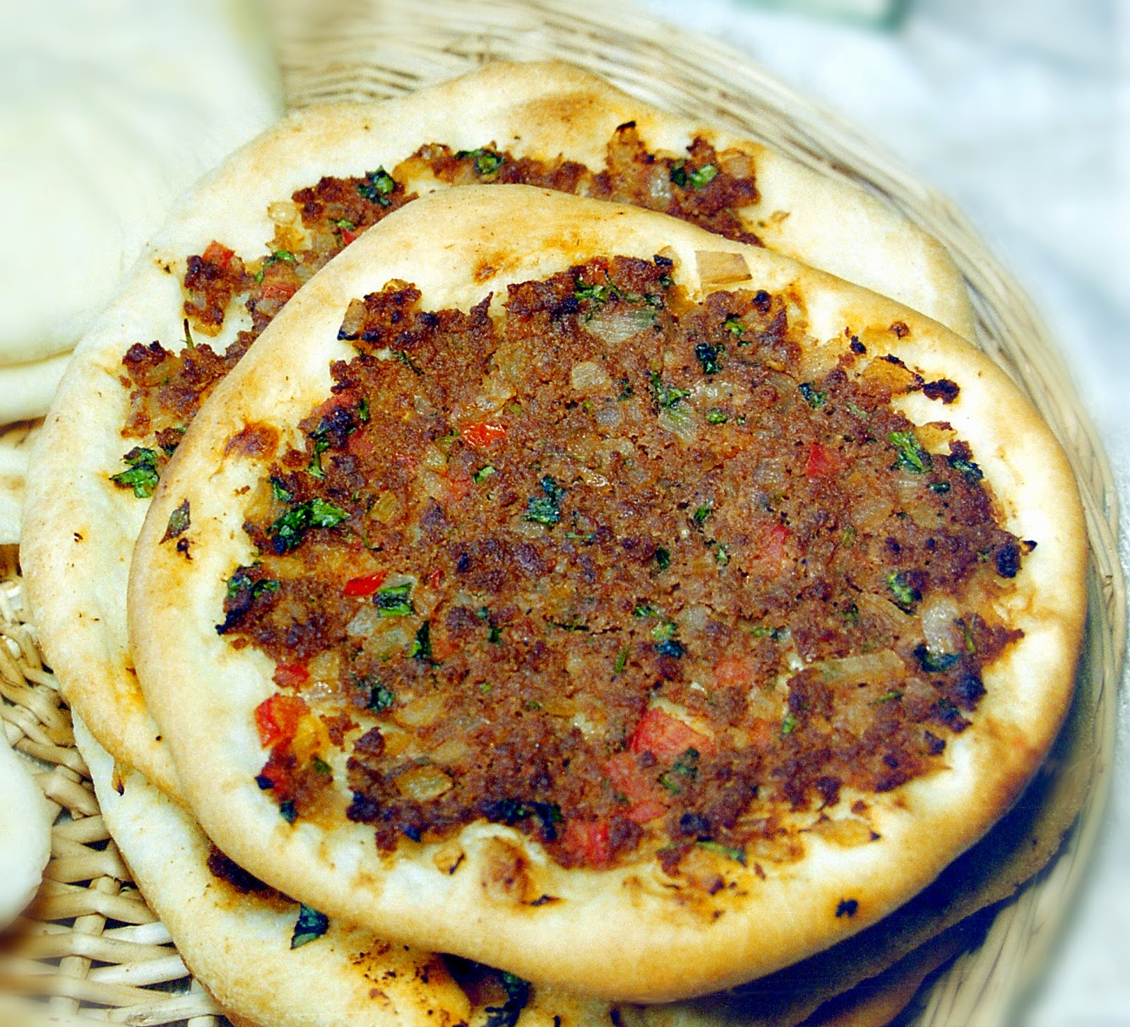 In my iraqi kitchen recipes history and culture by nawal nasrallah well loved carryout food in the levant and iraq simple practical and delicious equally ubiquitous in turkey where it is called lahmacun which no doubt forumfinder Images