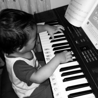 baby G playing the organ