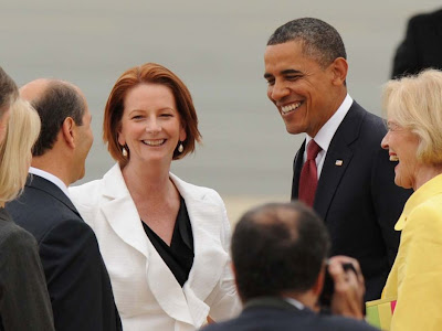 Julia Gillard and Barack Obama meeting and smiling in Australia