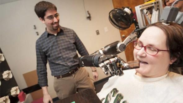 Quadriplegic Uses Her Mind to Control Her Robotic Arm