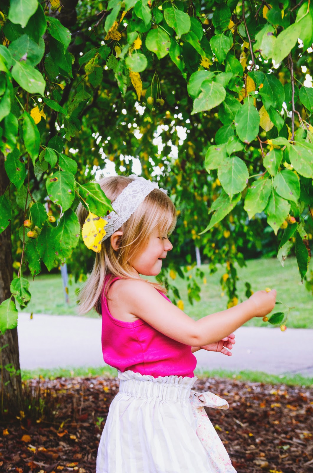 toddler in the trees at fresh, organic family photo session