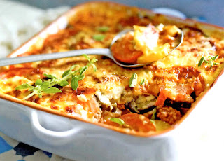 Lamb Moussaka: Classic Greek dish of lamb in a tomato sauce topped with vegetables and then a white cheese sauce that's oven baked in a baking dish