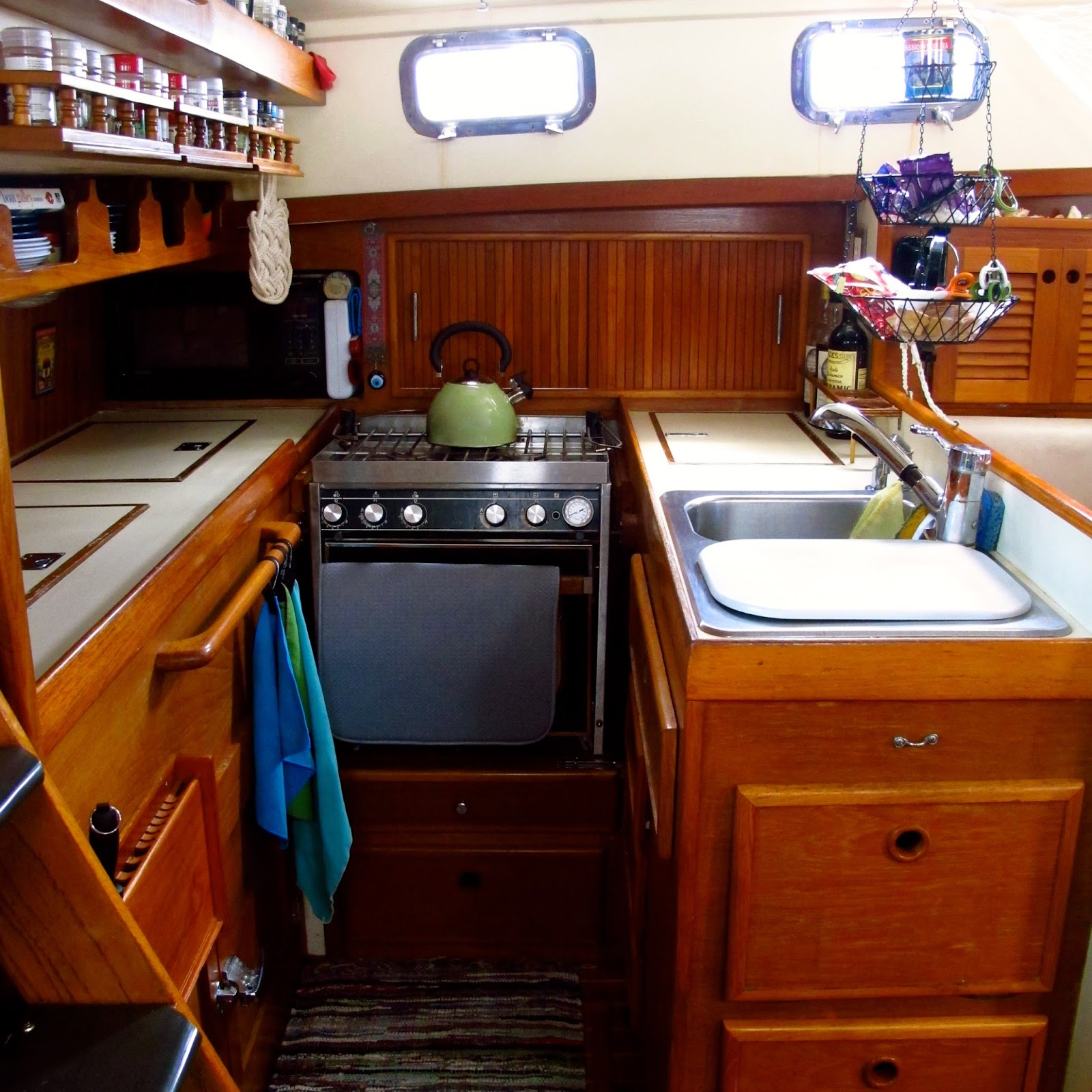 Windtraveler making a boat a home the art of decorating for Boat kitchen cabinets